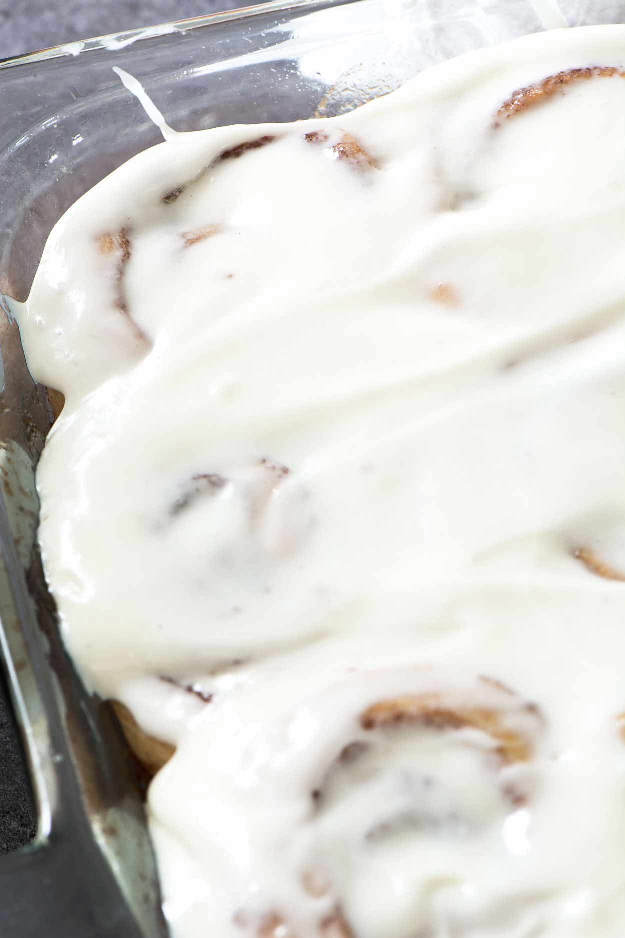 Made from scratch jumbo cinnamon rolls that are light and flaky. Filled with brown sugar, cinnamon and topped with a generous layer of cream cheese icing. | simplerevisions.com
